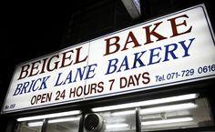 Beigel bakery, Brick Lane. Cheap, fast and open 24hrs. Salmon & cream cheese/salt beef please.