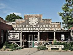 Blacksmith & Wagon Shop  -  		Ghost sign in the small town of Lindsborg, Kansas.