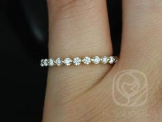 This simple yet interesting design is a must have classic! This ring is a slight twist the classic diamond eternity band!  All stones used are only