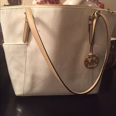 Authentic Michael Kors bag Brand new. NEVER WORN. This is my daughters bag. It was given to her as a gift. Not her style. Michael Kors Bags Totes