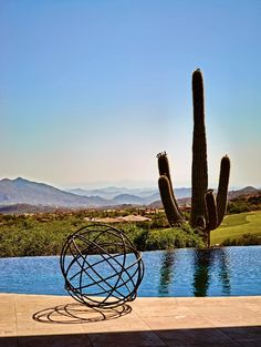 A metal sphere by Canadian artist-designer Martha Sturdy sits on the lip of an infinity-edge pool overlooking the Sonoran Desert. Infinity Edge Pool, Desert Oasis, Canadian Artists, Cool Pools, Traditional House, Beautiful Homes, Deserts, Texture, Fun Things
