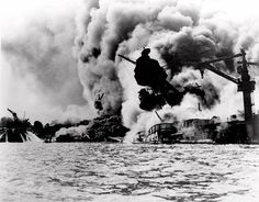 The USS Arizona in flames after being attacked on December 7, 1941 in Pearl Harbor, Hawaii.