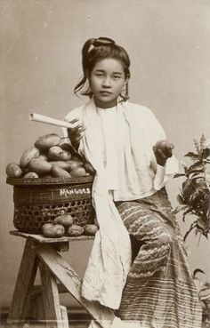 Portrait of a young woman selling mangoes, Mandalay c.1890. Photographer unknown.