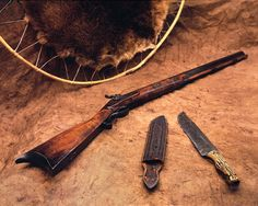 The original Hawken rifle, knife and scabbard carried by legendary mountain man Jeremiah Johnson are on display at the Cody Firearms Museum at the Buffalo Bill Center for the West in Cody, Wyoming. Shiloh Sharps, Cimarron Firearms, Jeremiah Johnson, Cody Wyoming, Black Powder Guns, Sergio Leone, Bush Craft, Robert Duvall, Tom Selleck