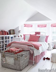 When decorating the guest bedroom of her house in Bridgehampton, NY, design consultant Ellen O'Neill picked out vintage red-checked bedding from a Paris flea market. It echoes the red-checked window-shade fabric from Ralph Lauren. Antique wicker hamper from Bloom. Iron bed from English Country Antiques.