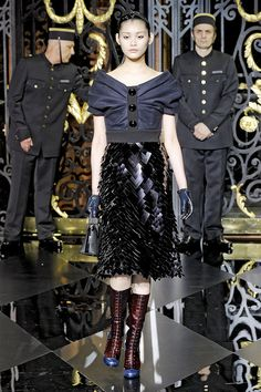 Louis Vuitton Fall 2011  the oversized buttons and bulky ruching on the top is beautiful