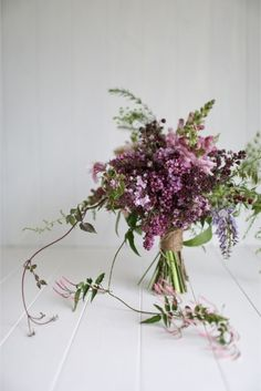 Wedding Flowers lilacs, greens, and lavender wedding bouquet - From rustic bunches to sweet magnolias, this wedding flower guide is a must-read for fresh floral arrangements for your big day! For more wedding tips go to Domino. Wedding Flower Guide, Lilac Wedding, Floral Wedding, Wedding Flowers, Wedding Tips, Lavender Weddings, Rustic Wedding, Trendy Wedding, Spring Wedding