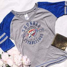 Oklahoma City Thunder Baseball Tee Oklahoma City Thunder Basketball top in a baseball style tee! Super soft and in great condition! It has blue burnout sleeves and the Thunder logo on the front surrounded by silver star jewels! NBA Tops Tees - Long Sleeve