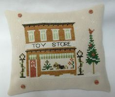 Toy Store Christmas Cross Stitched Mini Pillow by luvinstitchin4u, $20.00