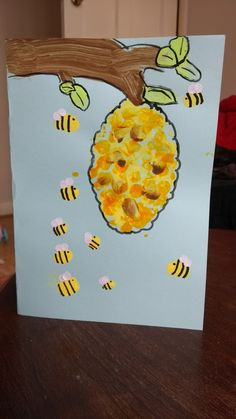 Bees and hive finger painting toddler craft.