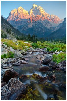 North Fork Cascade Canyon – Grand Teton National Park, Wyoming, USA. Most people visit Wyoming's Grant Teton National Park in July and August, when it's sunny and warm and the snow has melted in the high country