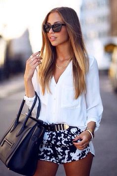Summer shorts. White blouse, belt, and black/white shorts. Cool