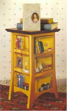 Love this trompe l'oeil on bookshelf drawers!