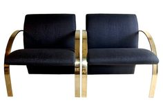 Vladimir Kagan Lounge  Chairs, Pair 2905..An outstanding pair of Vlaidmir Kagan lounge chairs for Directional. All original black fabric in perfect condition retaining Directional tag remnants. Vintage 1980's. Wool blend, brass.