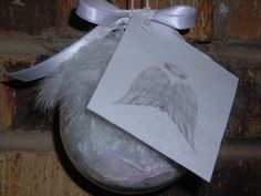 "Angel Feather Ornament is made from the feather of our Texas Angel Wings and accompanied by the ""Guardian Angel Poem"".Feathers from an AngelAre ones we rarely see.But these are quite different,And as special as can be.These feathers are a reminderOf a special persons love,Who is now your Guardian Angel.Watching and protectingFrom above.The feathers are preserved in a clear ball with heaven dust (glitter). The poem is printed on card-stock and laminated with ""heaven dust"".The ball is plastic so …"