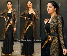 Anasuya taped a TV show wearing a plain black saree that has gold border paired with matching blouse and brocade long jacket by Gauri Naidu. saree with long jacket Kerala Saree Blouse Designs, Saree Jacket Designs, Kurta Designs, Black Saree Designs, Indian Gowns Dresses, Indian Fashion Dresses, Indian Designer Outfits, Designer Dresses, Saree Wearing Styles
