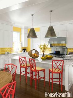 In a kitchen by Jesse Carrier and Mara Miller, two bright primary colors come together for a vivacious pairing, made all the more spring-ready by the natural textures of the baskets.