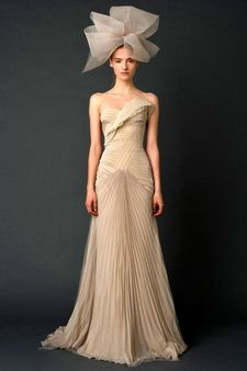 Don't think I could pull off the hat, but I love the architectural elements of the dress.
