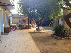 Jardín de uno de nuestros alojamientos en Valencia. Home Stay Pack