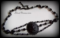 DROP DEAD Gothic Skull and Crossbones Victorian Mourning Black Noir Beaded Cameo Choker by Blood Flowers Jewelry. $28.00, via Etsy.