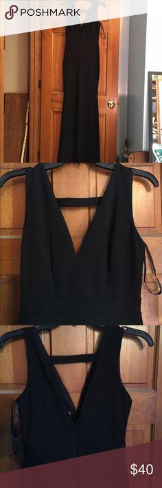 NEW, never worn. Long black dress, fitted. Black with deep V-neck. Windsor Dresses