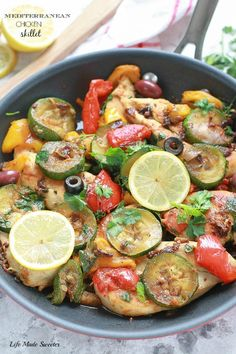 The easiest & tastiest one pan skillet meal full of Mediterranean flavors - chicken, zucchini, bell peppers, sun-dried tomatoes, lemon & fresh herbs.