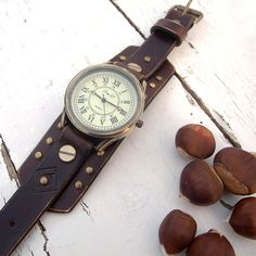 Brown, rustic leather watch with Vintage Retro Style watch face.  Made from top quality vegetable tanned leather.    With antique bronze buckle closure