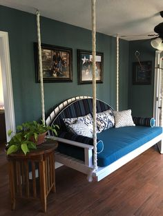 Hanging day bed.  Sunbrella fabric used for cushions.