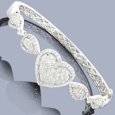 This gorgeous 14K Diamond Heart Bangle Bracelet showcases 2.68 ctw of invisibly-set princess cut diamonds and pave-set round diamonds. Featuring a lovely heart design and a highly polished 14K gold finish, this luxurious ladies diamond bangle bracelet is available in 14K white, yellow and rose gold.