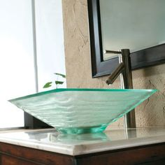 @Overstock - Stylish and functional, this tempered glass vessel sink from CAE provides a modern look for your bathroom. This durable sink is complete with a brushed nickel finished, single lever faucet.   http://www.overstock.com/Home-Garden/CAE-Tempered-Glass-Sink-with-Brushed-Nickel-Faucet/7492642/product.html?CID=214117 $156.99