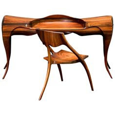 1965 Wendell Castle Vermilion Desk and Chair  United States  1965  This desk and chair, made of Vermilion wood, is certainly a tour de force by America's preeminent wood worker. Owned by a family in Rochester, NY, this desk and chair are new to the market, having been in a single family's possession since purchasing it from Wendell Castle in 1965. poa