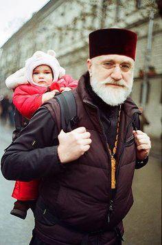 Orthodox priest babywearing!