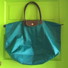 || LONGCHAMP || Giant turquoise nylon&leather tote In used condition. It looks like there is a tiny burn mark on the bottom, or a hole or something. I pictured it in number 4. There are some scratches, but nothing would show up in pictures. Longchamp Bags Totes Longchamp, Totes, Turquoise, Number, Tote Bag, Best Deals, Womens Fashion, Pictures, Leather