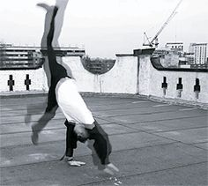 Tom Hiddleston does a cartwheel GIF LOOK AT ALL THAT LEG!