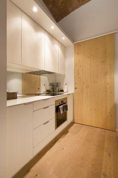 Behind the wooden door is where the kitchen supplies are hidden.