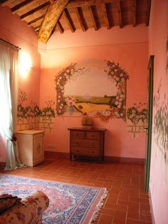 La Suite Le Rose dell'agriturismo romantico Taverna di Bibbiano. La Suite offre ai suoi ospiti un arredo di charme, trompe l'oeil e decori a temi floreali e una splendida  vista sulla campagna toscana