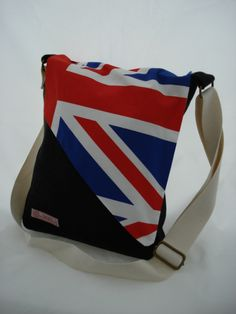 BP16  Chic Messenger Bag in black felt with Union Jack flap  Adjustable strap that can be worn over the shoulder or across the body  Fully lined with 3 interior pockets  Approx measurements 26cm x 34cm excluding strap