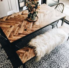 Unique dining table with benches and faux fur throws