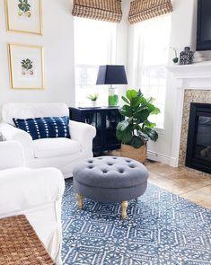Using blue in your home-blue living room with indigo shibori pillows and blue and white rug #livingroom #blueandwhite #bluedecor