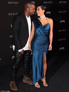 Someone's a fan: Kanye West couldn't take his eyes off his wife as they posed on the red carpet