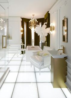 Luxurious bathroom designed by Jonathan Adler. Disco-lit floors, retro hues and futuristic forms create a playful and eccentric space in this bathroom.