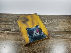 Check out this item in my Etsy shop https://www.etsy.com/listing/460183138/coolest-cat-wooden-journal-personalized