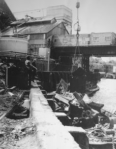 Robinson's workers monitoring the loading of scrap metal from a barge moored at Anchor Iron Wharf | Pat O'Driscoll