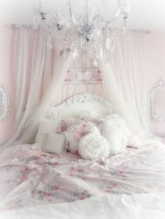 This must be the ultimate princess bedroom. That chandelier is so elegant. I love that the bed is big and roomy with the nice headboard and all the pillows. And of course, you can't have a princess bed without a fluffy canopy overtop.