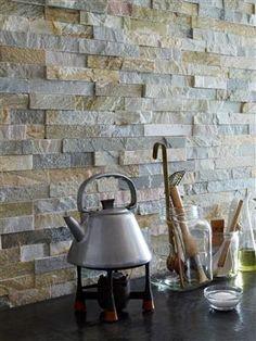 Striking stone backsplash - love it for the kitchen!