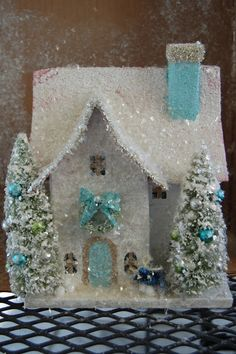 Natalie Loves...: Do-it-yourself glittered Christmas houses. I painted the chimney and door aqua, added glass glitter trim, and then used vintage miniature ornaments to adorn the trees and finished it off with a handmade bird.
