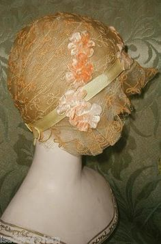 "1920s Flapper era hat. Frilly and feminine, made of (faux) horsehair ""lace"" braid w straw braid woven through in lovely designs. The cloche hugs the head very close, and the beautiful draped ruffled brim hides the face and creates a sort of ""windblown"" effect. This is what was often called a ""transparent"" hat as it was almost see-through."