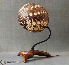 Creative ways to light up a room with amazing exotic gourd Lamps by Calabarte. Each gourd lamp is made from a gourd brought from Senegal and their exotic Gourd Lamp, Cool Lamps, Shell Crafts, Light Art, Craft Patterns, Lamp Design, Gourds, Natural Materials, Wood Art