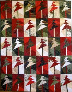 If I had $400 to spare, I'd buy this beautiful Christmas quilt!