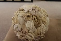 Burlap, linen, and tulle rosette topiary diy,this would look great in a clay pot with a burlap ribbon tied around it.  You could also spray paint the pot any color!